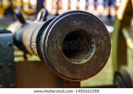 cannon black barrel close-up, medieval weapons for long-range shooting and defense of the fort #1482662288