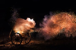 Cannon blast with sparkles flying out.