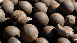 cannonballs stacked in a pile of one caliber for firing smoothbore cannons to destroy wooden hulls of ships and fortress, 18th century, Al Fahidi Historical, Dubai.