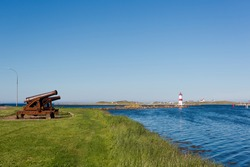 Cannons and a lighthouse on the French island of Saint Pierre.