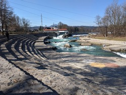 Canoe and kayak white water facilities in Tacen, Slovenia. Canoe slalom competitors training in fast flowing river with slalom gates