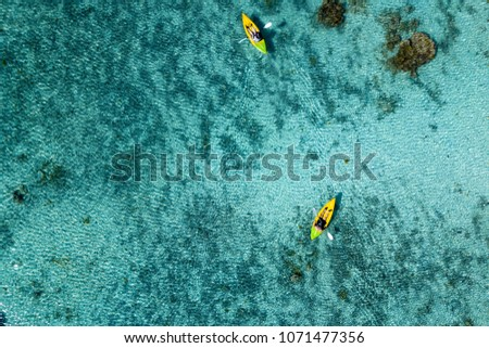 Canoe and kayaks in Polynesia Cook Islands tropical paradise Aitutaki panorama landscape #1071477356