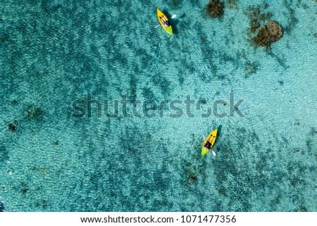 Canoe and kayaks in Polynesia Cook Islands tropical paradise Aitutaki panorama landscape #1071477356