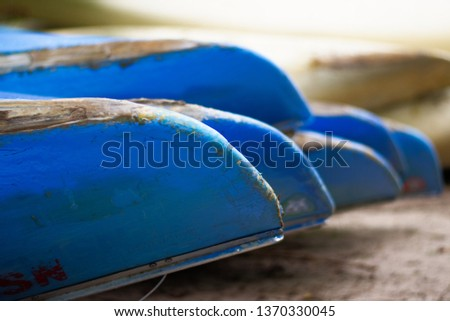 Canoe Bokeh Close Up Row of Canoes Upside Down on the Sand of Beach River or Lake