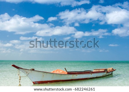 Canoe floating on calm water under beautiful blue sky #682246261