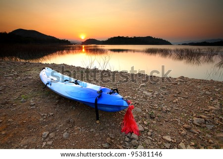 Canoe Kayaks at waters edge on Lake Kaeng Krachan Dam, Thailand