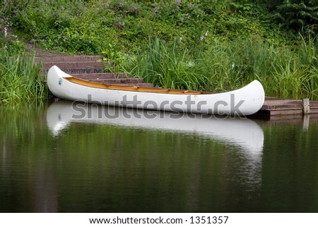 Canoe on lake - stock photo