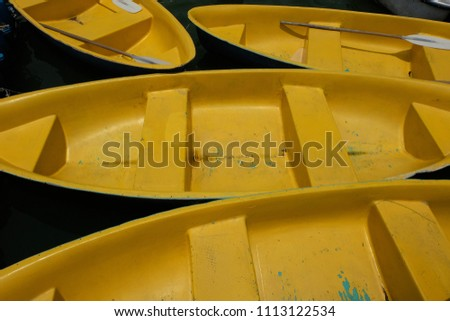 Canoe on Lake., Yellow wood canoes in still water. #1113122534