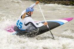Canoe slalom athlete racing on white water