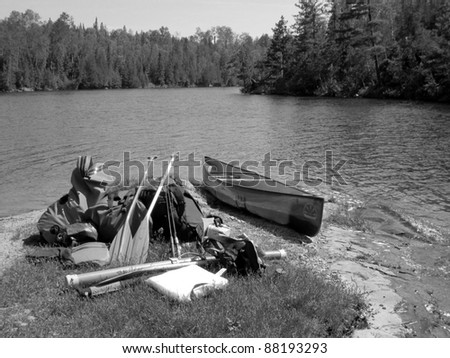 canoe supplies sitting on a boundary waters beach