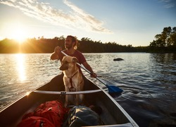 Canoe tour with a dog and a man in sweden