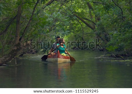 Canoeing in the water passages of Lake Tisza