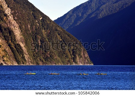 Canoeing on Fiordland national park in southern New Zealand.