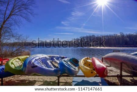 Canoes  and Kayaks awaiting a rider on a wintry day #1147147661