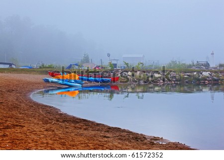 canoes and kayaks in early morning light