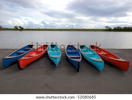 Canoes by a lake