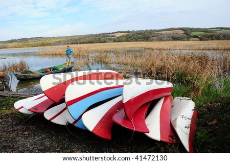 canoes by lake