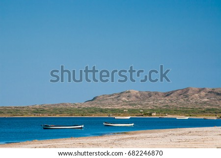 Canoes floating on calm water under beautiful blue sky #682246870