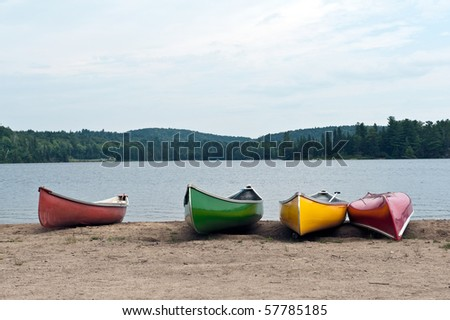 Canoes on the shore of Two rivers lake Algonquin Park in Ontario Canada