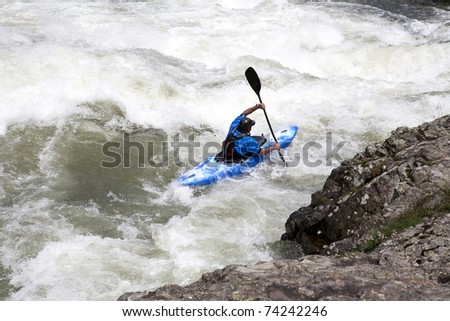 canoing on white water river