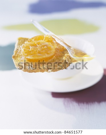 Canola oil and orange marmelade on bread