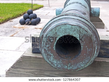 Canon and cannonballs, in a fort, overcast day. Castillo de San Marcos, St. Augustine, Florida. 16th century.