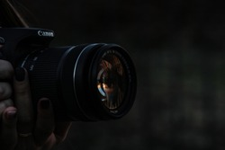 canon reflex with colosseum reflection