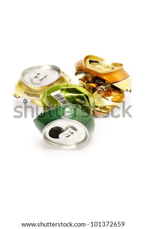 Cans of drinks crumpled on a white background