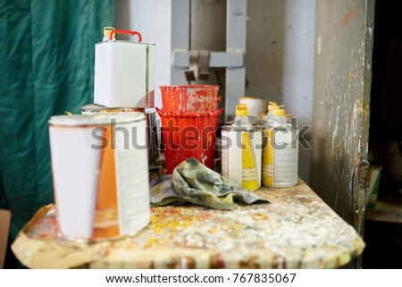 Cans of paint. Red, yellow and orange paint. Stock photo ©