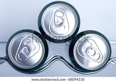 Cans of soft drink in a Refrigerator - stock photo