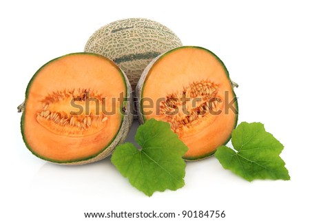 Cantaloupe melon whole and in halves with leaf sprigs isolated over white background.
