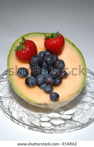 cantaloupe with blueberries and two strawberries 2