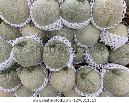 Cantaloupes displaying in stacks. #1298311513