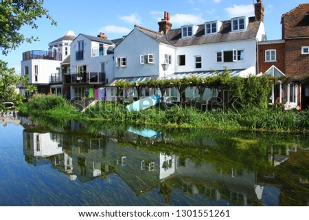 Canterbury, lovely hamlet close to London at summer. White houses reflecting on the river. #1301551261