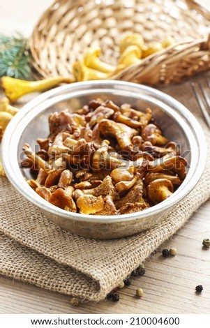 Cantharellus cibarius, commonly known as the chanterelle, golden chanterelle or girolle. Roasted mushrooms.