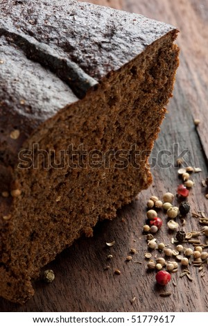Cantle and slice of dark rye bread or cake