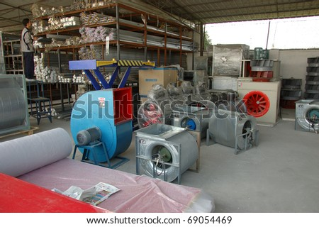 CANTON, CHINA - NOVEMBER 11: One of the biggest manufacturer of auto spray booths and generators in China. Warehouse with components for generators on November 11, 2010 in Canton, China.