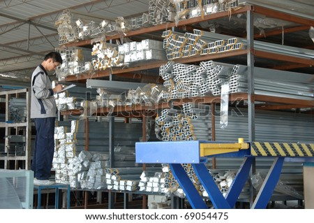 CANTON, CHINA - NOVEMBER 11: One of the biggest manufacturer of auto spray booths and generators in China. Warehouseman checks raw material on November 11, 2010 in Canton, China.