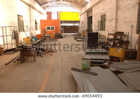 CANTON, CHINA - NOVEMBER 11: One of the biggest manufacturer of auto spray booths and generators in China. Warehouse with metal components on November 11, 2010 in Canton, China.
