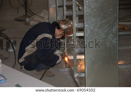 CANTON, CHINA - NOVEMBER 11: One of the biggest manufacturer of auto spray booths and generators in China. Welder working on aluminum frame on November 11, 2010 in Canton, China.