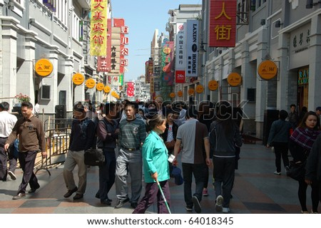 CANTON, CHINA - OCTOBER 28: Shangxiajiu Pedestriant Street in Guangzhou on October 28, 2010. Famous shopping street with many shops and restaurants was reconstructed for Asia Games 2010.