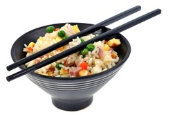 Cantonese rice bowl with Chinese chopsticks close-up on white background