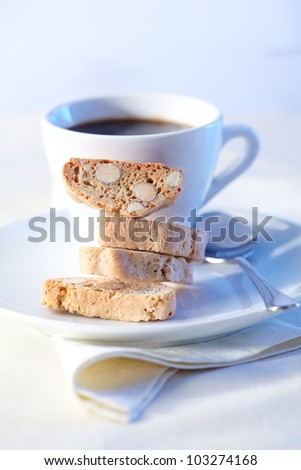 Cantucci cakes and cup of coffee on background