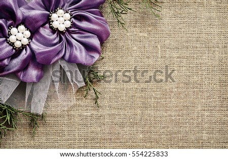 Canvas background with textile flowers arrangement in a corner