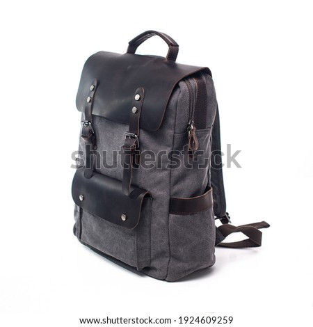 Canvas Backpack accessories isolated on white background. Hand made backpack for travelers. Сток-фото ©