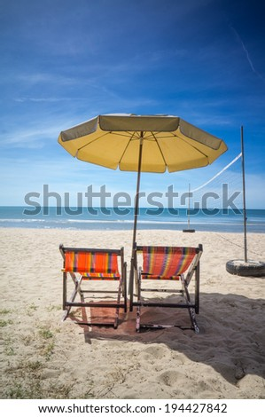 canvas bed on the beach with volleyball net #194427842