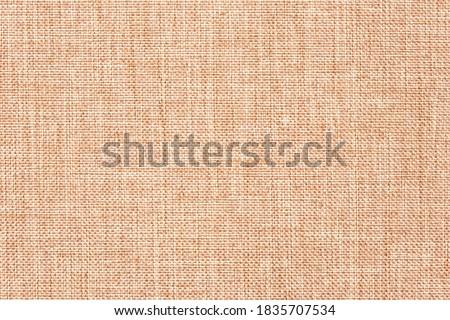 Canvas cloth, burlap, rustic home decor. Natural jute hessian, texture. Linen fabric pattern. Abstract light brown textile background. Woven wallpaper. Foto d'archivio ©