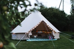 Canvas cotton Bell tent in the yard decorated for summer kids party
