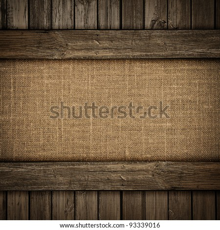 Canvas on wood background or texture