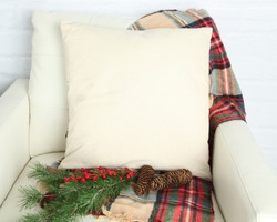 Canvas Pillow square pillow mockup on white leather chair with Christmas props and white brick background